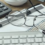 eyeglasses on a keyboard
