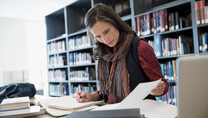 woman studying in library