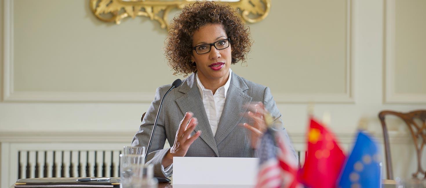 National security advisor speaking at her desk