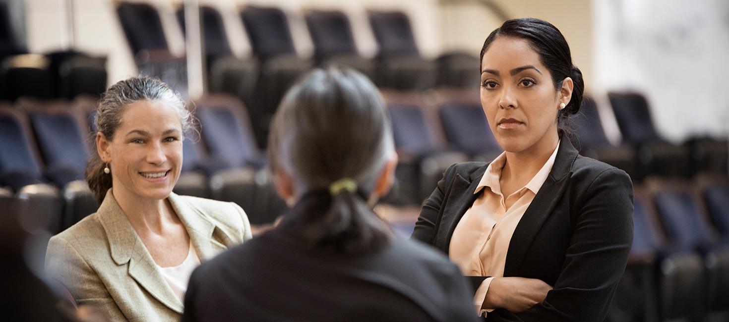 Legislators conversing in a courtroom