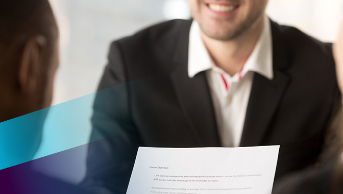 employer reading a resume