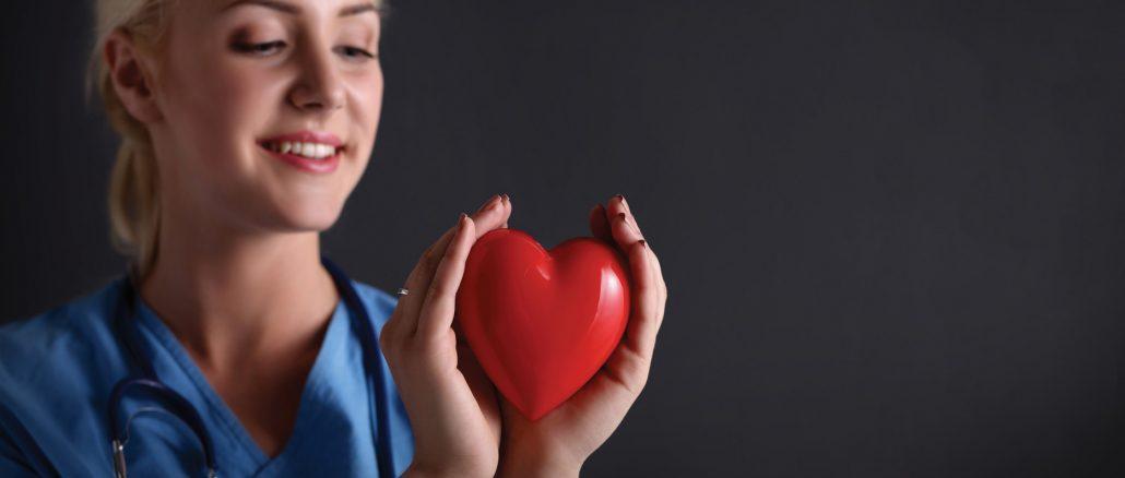 nurse holding a heart