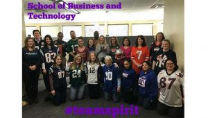 excelsior employees dressed in football jerseys