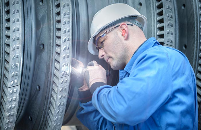 Technician inspecting machinery