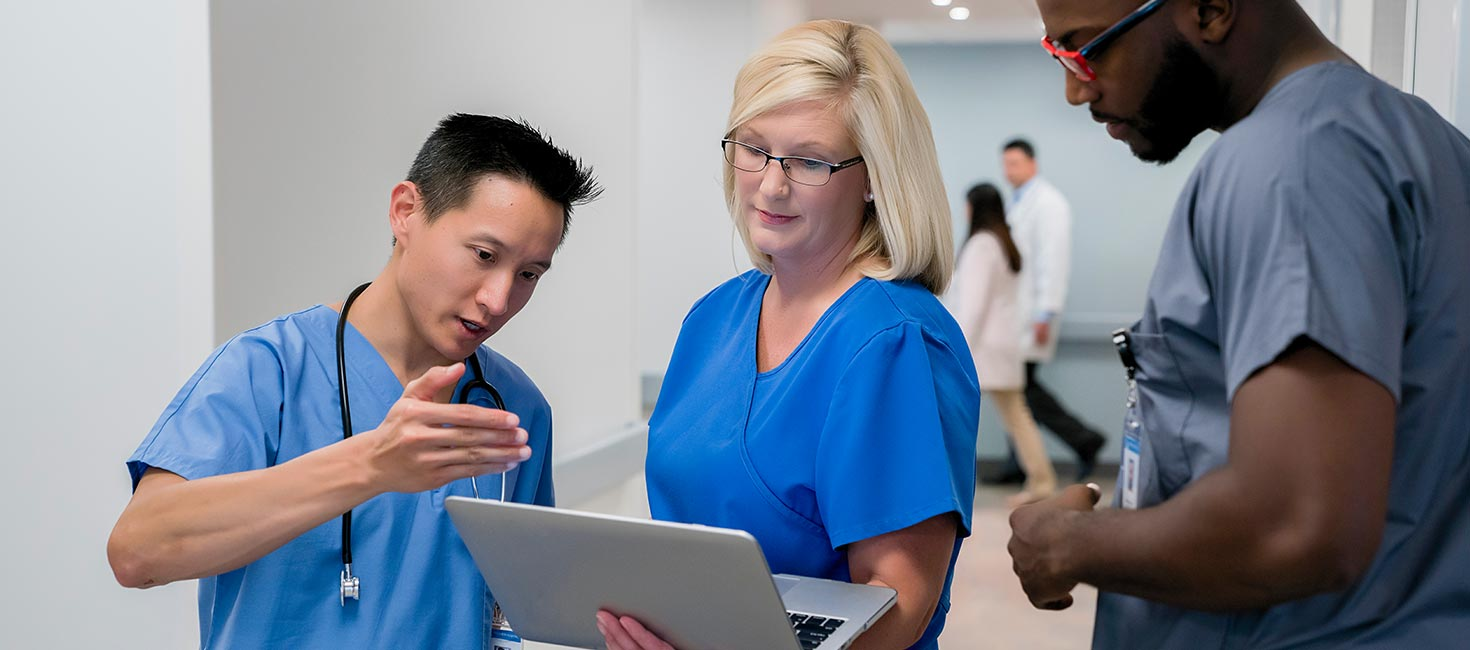 Nurses consulting on patient care