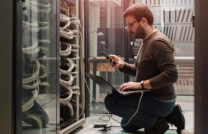 Server engineer setting up a network server and communicating the results
