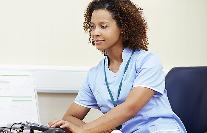 Nurse looking at an informatics display