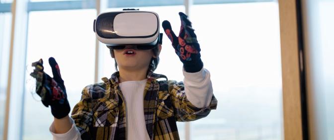 Child using virtual reality goggles