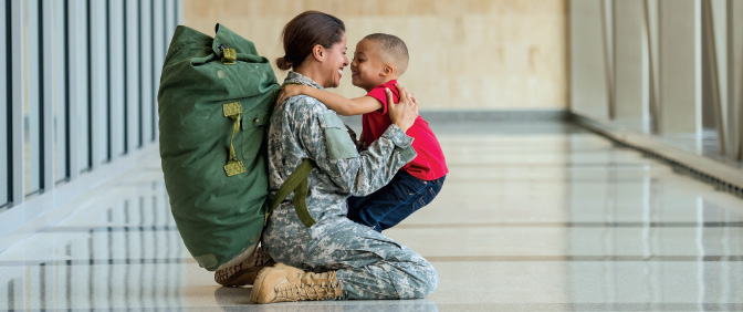 Female servicemember and child