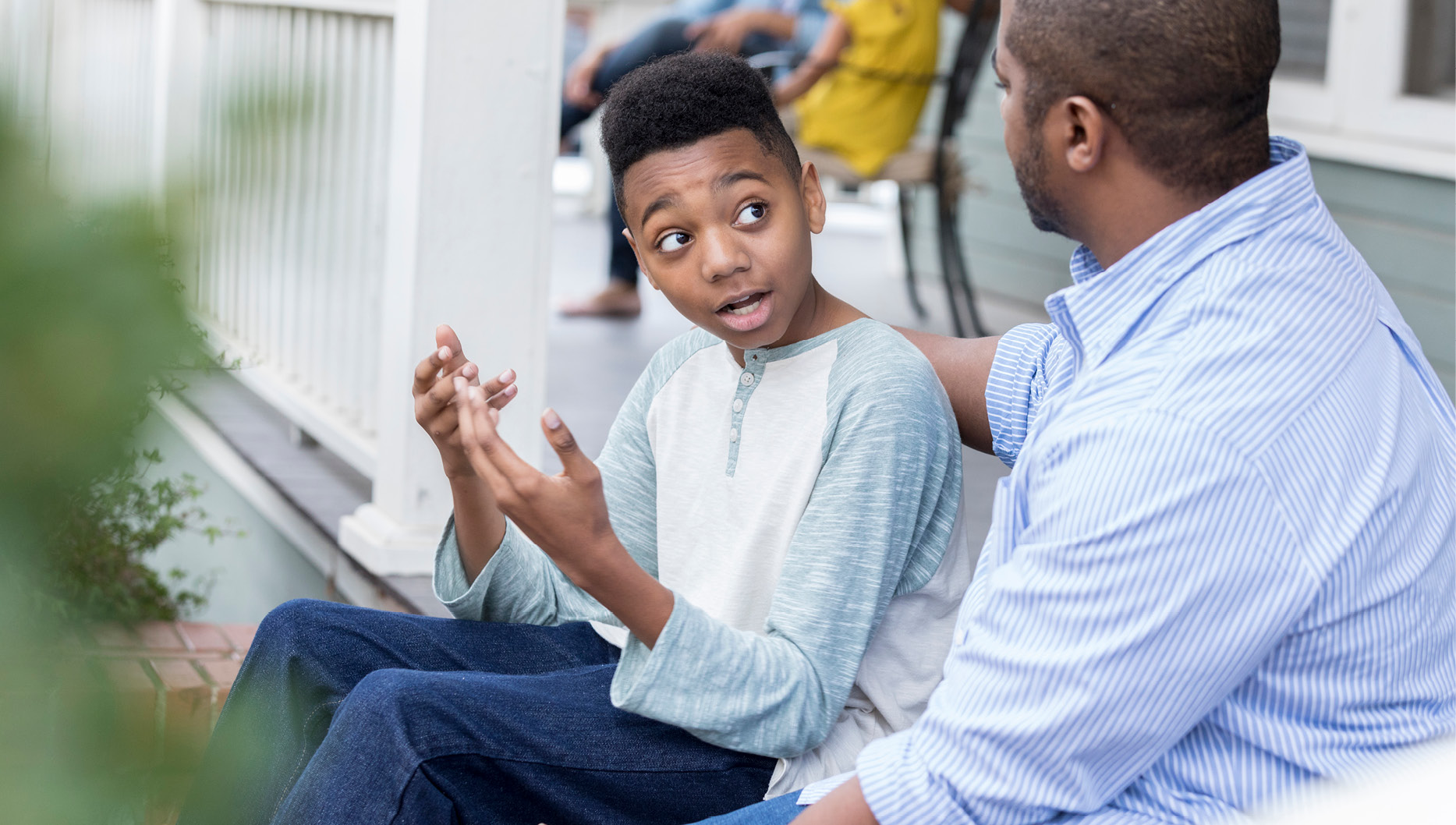 african american dad talking to son instead of putting him in time out