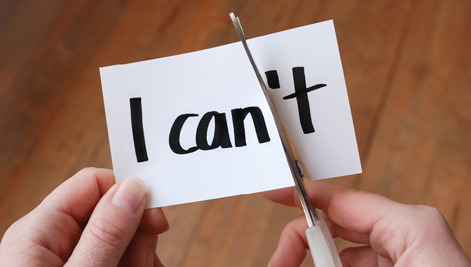 "scissors cutting through a paper that reads ""I can't"""