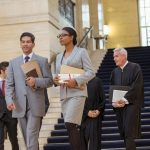 lawyers walking through a court house and the start of the criminal justice system