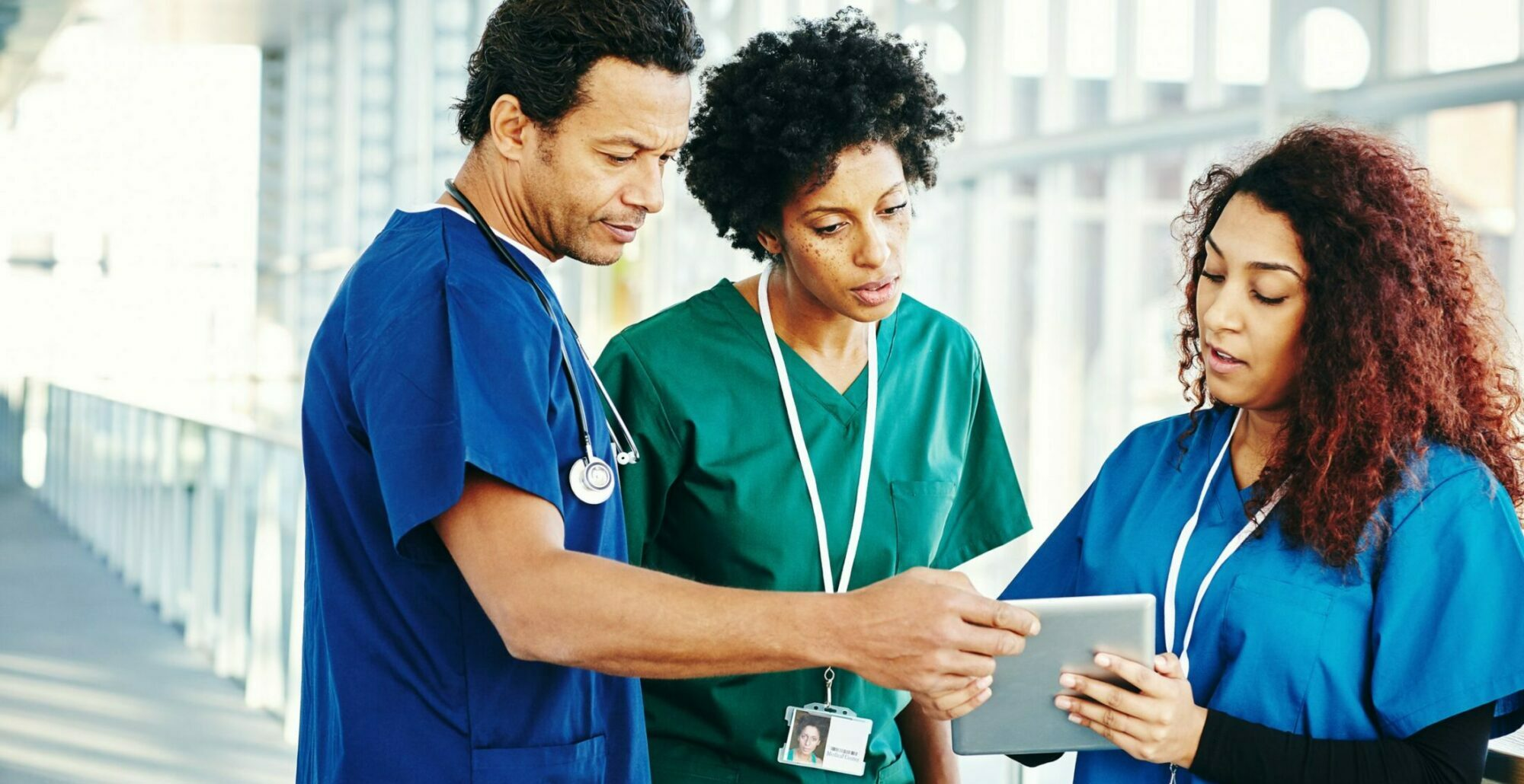 diverse group of nurses looking at a patient chart.