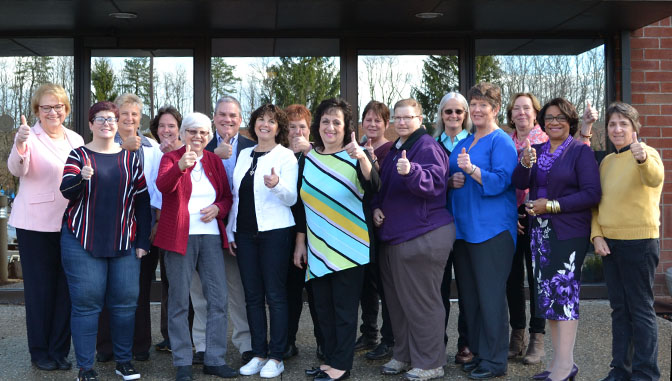 excelsior employees with more than thirty years longevity give thumbs up