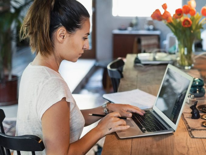 woman at computer, going back to school with GI Bill Benefits
