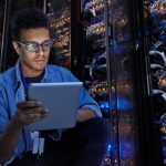 Man in server room, it and cyber roles