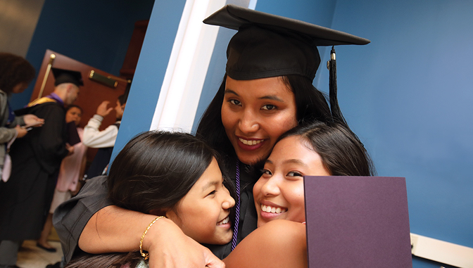 Graduate with daughters