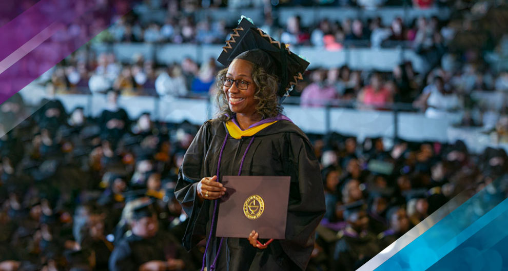 Excelsior College graduate receiving diploma at commencement