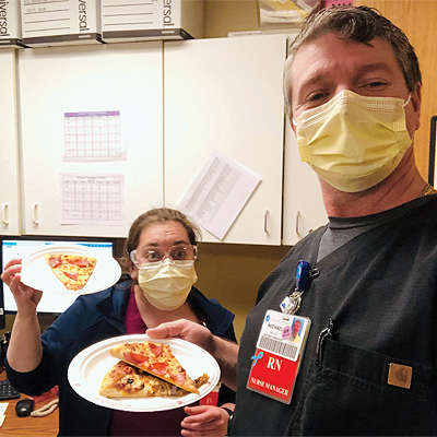 Health Care workers eating pizza