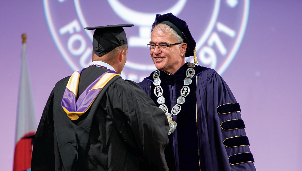 James N. Baldwin Congratulates a graduate