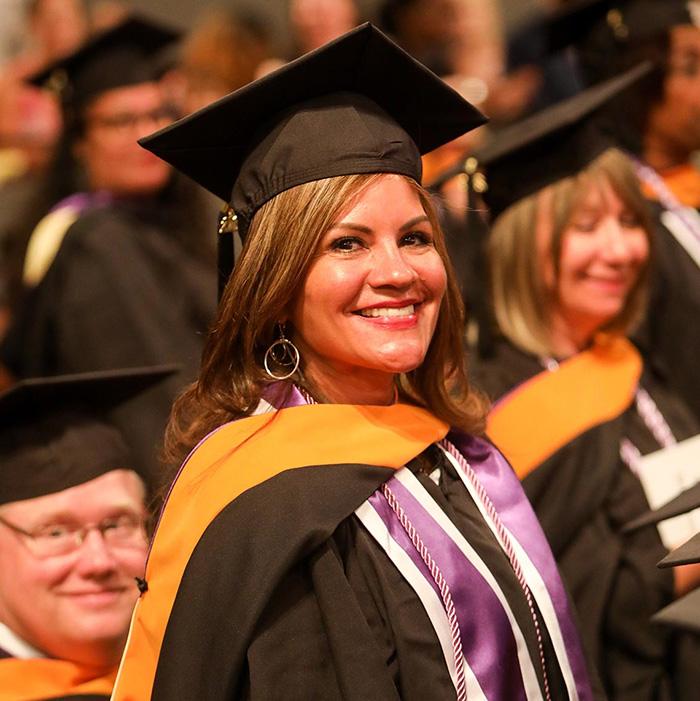 Excelsior graduate smiling
