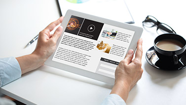 Person holding tablet and reading articles