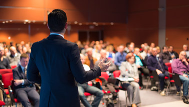 Man presenting to audience at conference