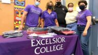 Excelsior College employees at the school supply drop off event