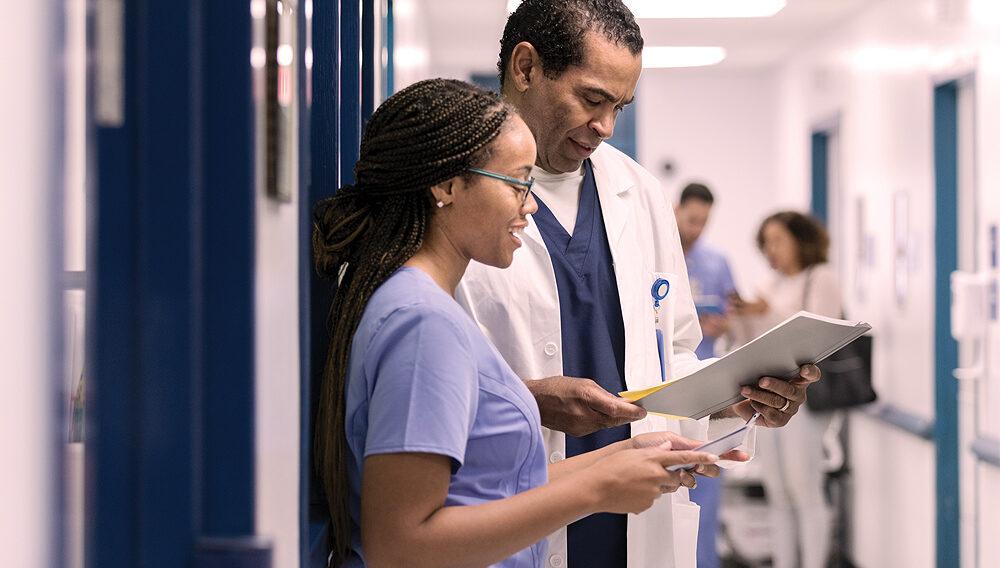 Nurses looking at patient data